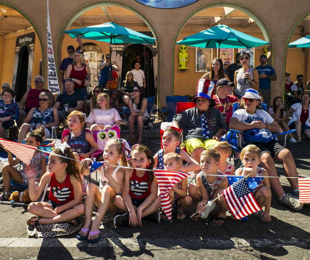 Young spectators watch parade participants pass by at the annual Damboree Celebration in Boulde ...