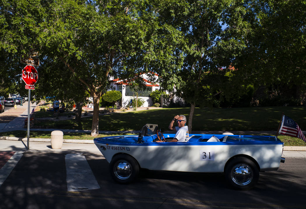 Boulder City resident Kevin Savord drives is boatcar before participating in the parade at the ...