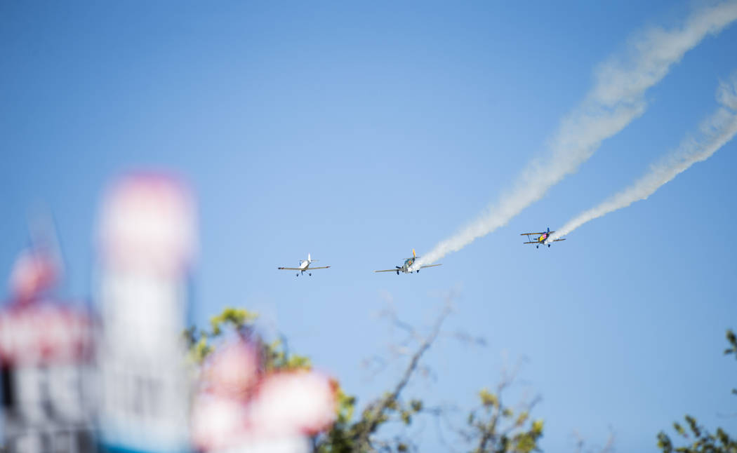 Planes manned by members of the Boulder City Veteran's Flying Group fly overhead during the par ...