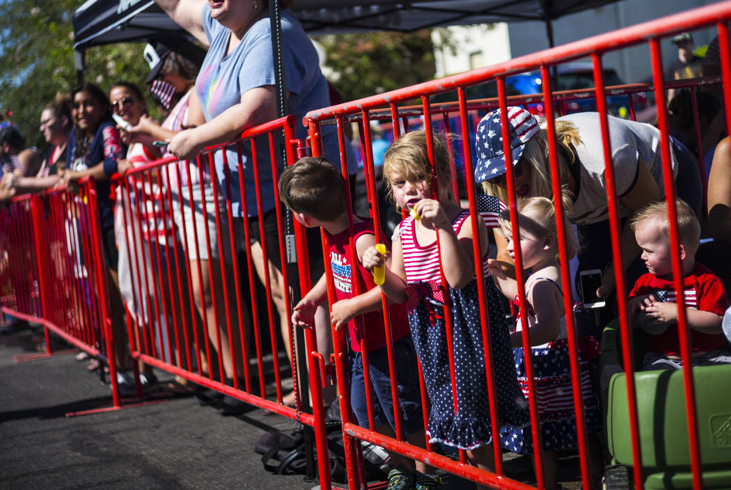A young spectator blows bubbles while watching the parade at the annual Damboree Celebration in ...