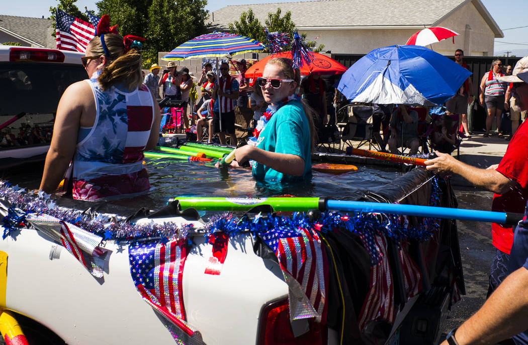 Parade participants prepare to partake in water fights during the parade at the annual Damboree ...
