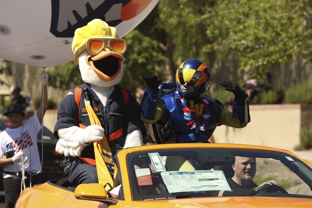 Las Vegas Aviators mascots wave at spectators during the 25th annual Summerlin Council Patrioti ...