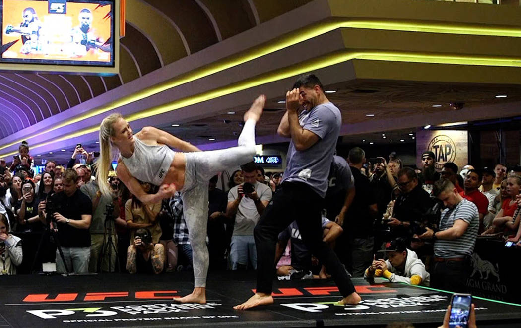 UFC bantamweight contender Holly Holm launches a kick at the open workouts at the MGM Grand hot ...
