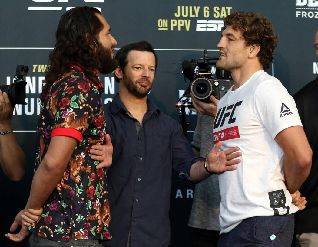 UFC welterweight Jorge Masvidal, left, and Ben Askren, right are kept apart by matchmaker Sean ...