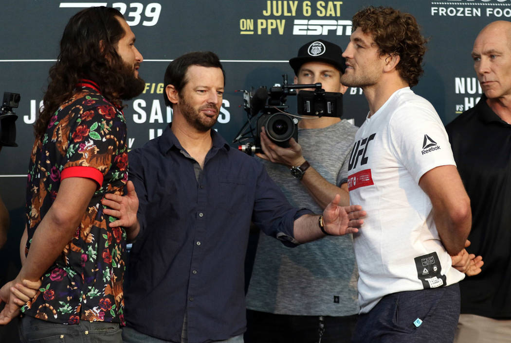 UFC welterweight Jorge Masvidal, left, and Ben Askren, right are separated by matchmaker Sean S ...