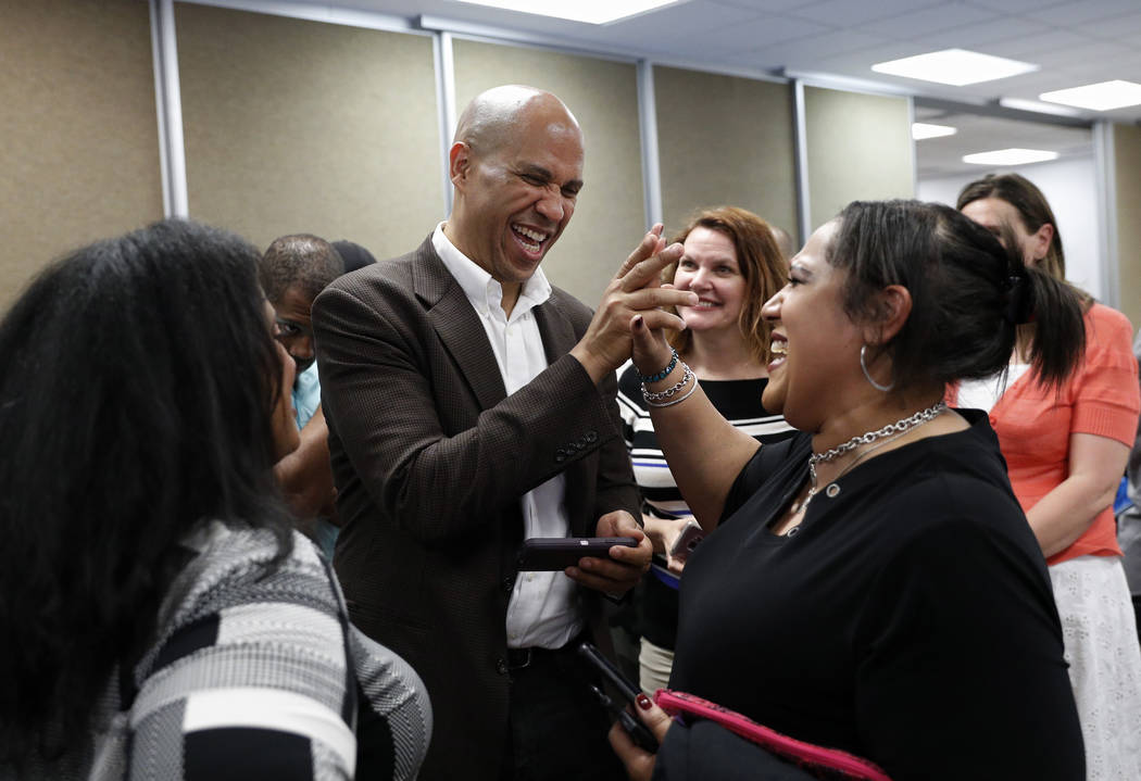Democratic presidential candidate Sen. Cory Booker meets with people after speaking at a Vetera ...