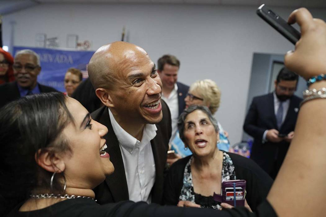 Democratic presidential candidate Sen. Cory Booker poses for a selfie during an event at a Vete ...