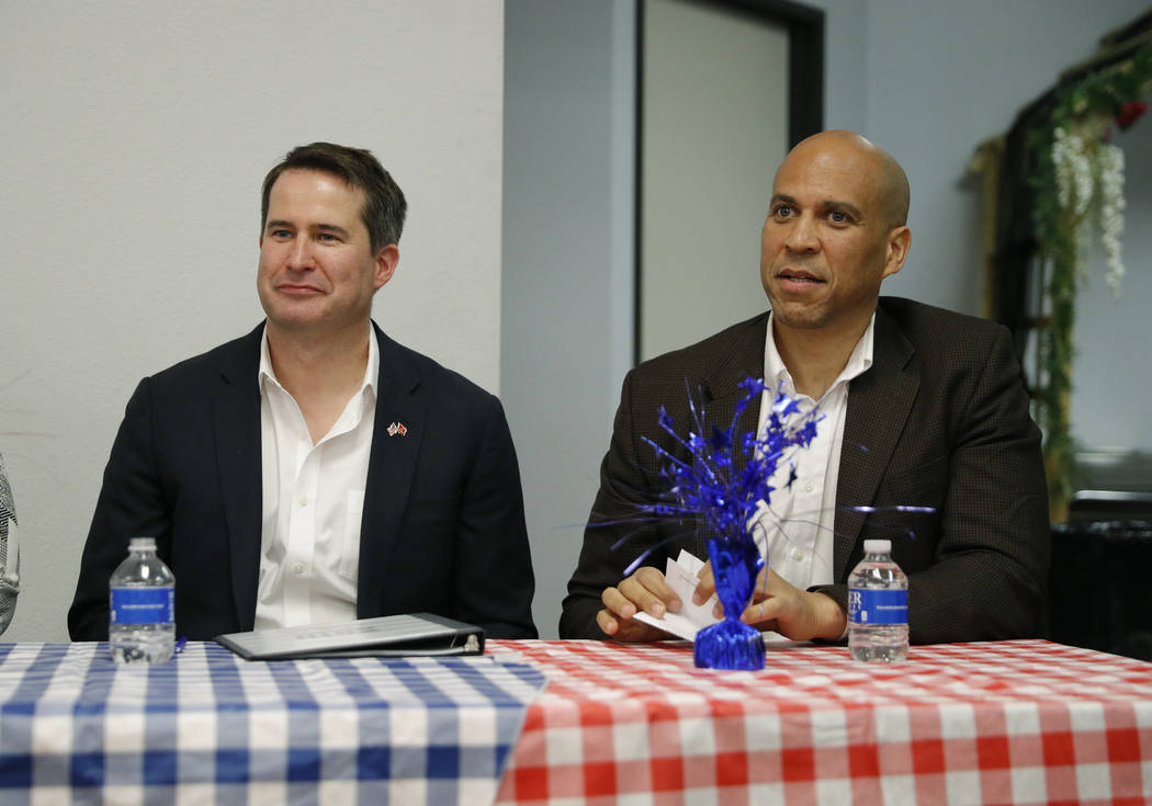 Democratic presidential candidates Rep. Seth Moulton, D-Mass., left, and Sen. Cory Booker atten ...