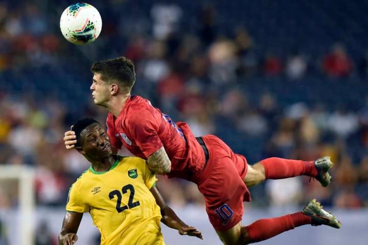 United States midfielder Christian Pulisic (10) heads the ball above Jamaica midfielder Devon W ...