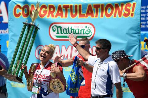 Miki Sudo reacts after receiving her trophy and belt for winning the women's competition of Nat ...