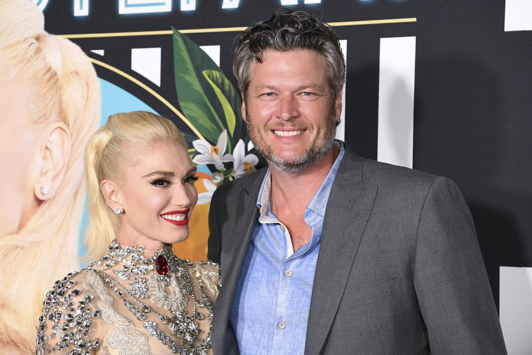 Gwen Stefani and Blake Shelton arrive on the red carpet for her new residency at Planet Hollywo ...