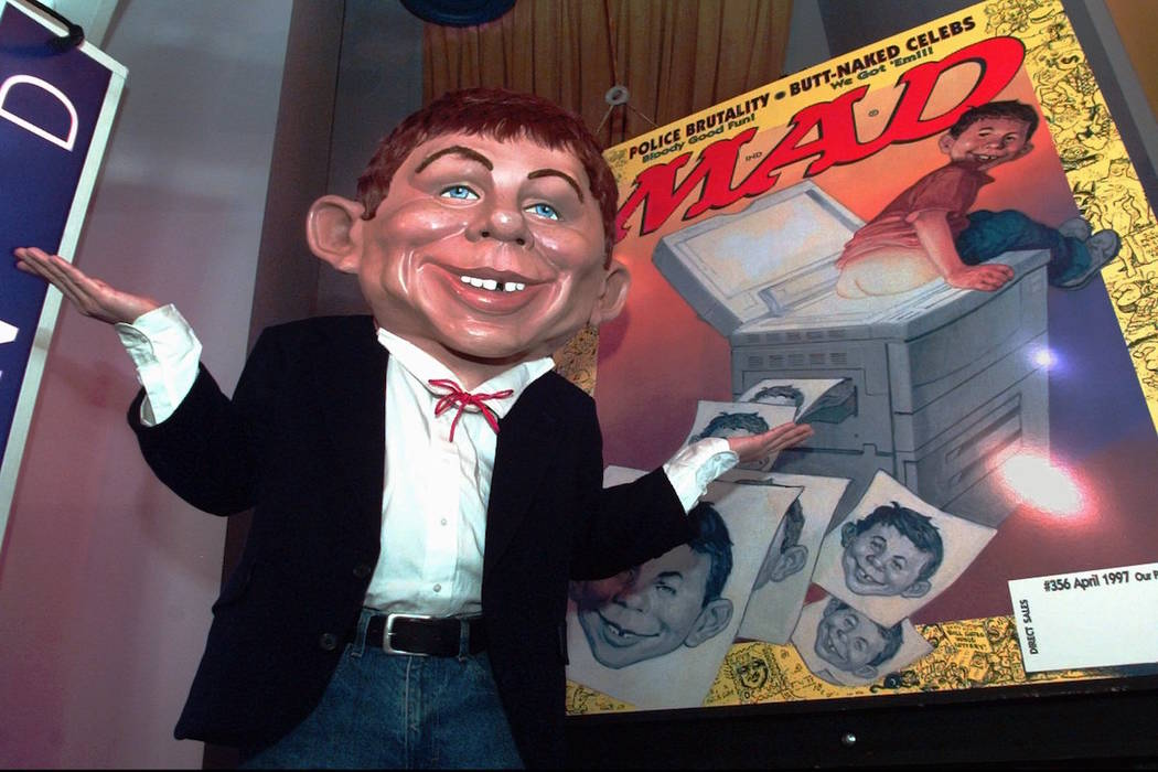 Mad Magazine mascot Alfred E. Neuman shows off the debut cover of the publication's new look at ...