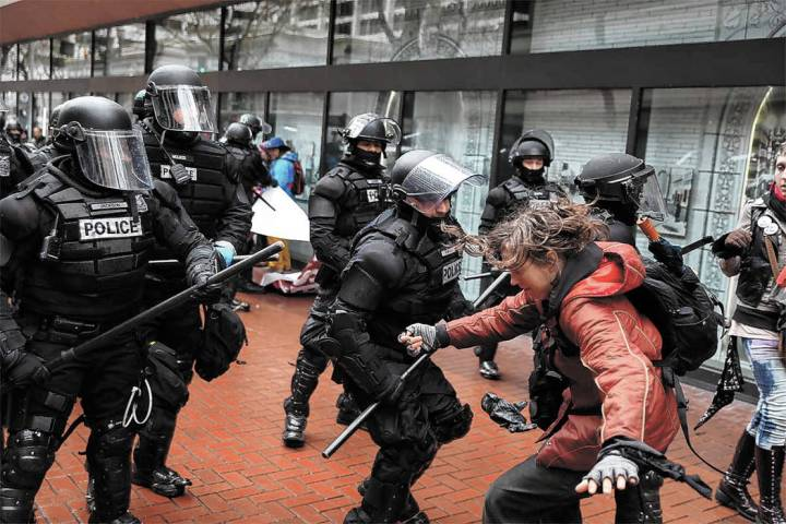 FILE - In this Monday, Feb. 20, 2017 file photo protesters clash with police, in Portland, Ore. ...