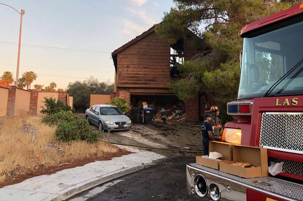 A home being renovated at 1608 Eaton Drive, near West Oakey Boulevard, caught fire about 3:40 a ...