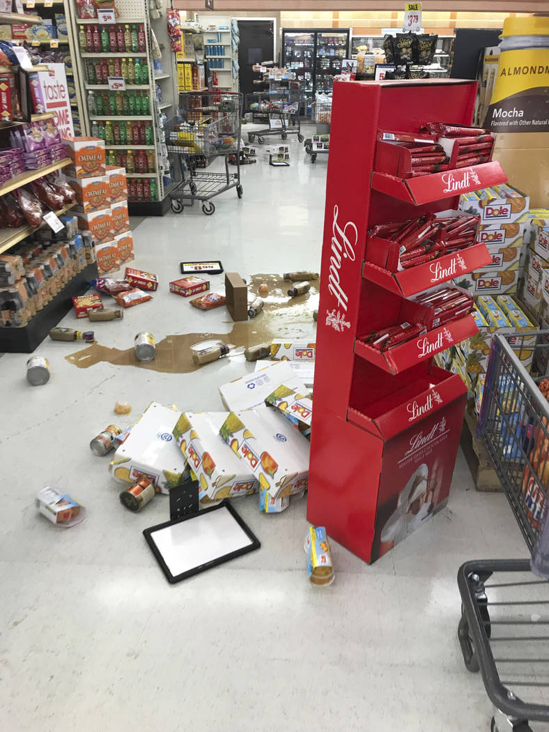 Food and other damaged merchandise are strewn on the floor at the Stater Bros after an earthqua ...
