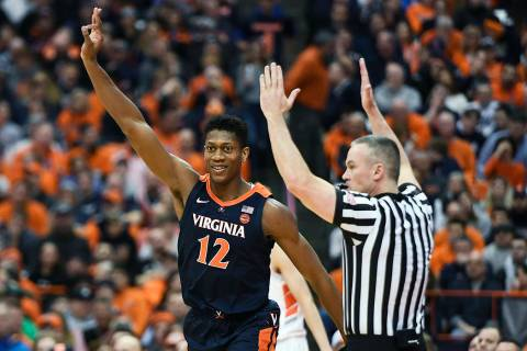 Virginia guard De'Andre Hunter celebrates a three-point basket during the second half of an NCA ...