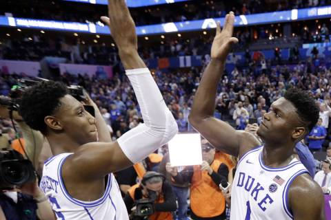 Duke's RJ Barrett (5) and Zion Williamson (1) celebrate after defeating Florida State in the NC ...