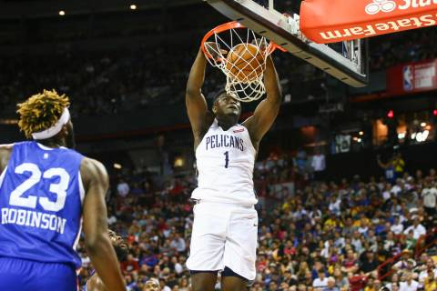 New Orleans Pelicans' Zion Williamson (1) dunks against the New York Knicks during the first ha ...