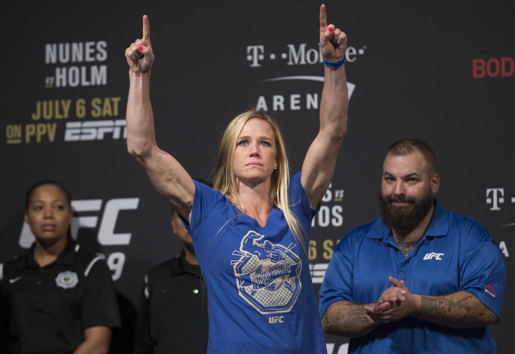 UFC bantamweight Holly Holm points to the crowd during weigh ins for UFC 239 on Friday, July 5, ...