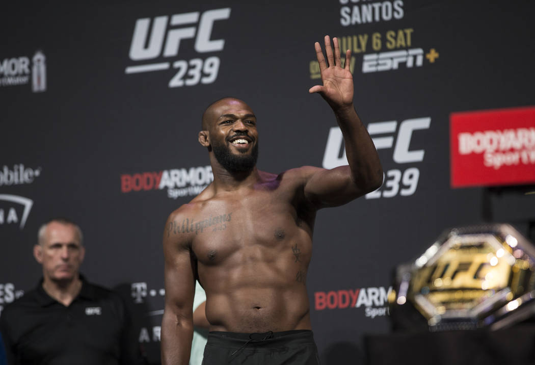 UFC light heavyweight champion Jon Jones waves to his fans during weigh ins for UFC 239 on Frid ...