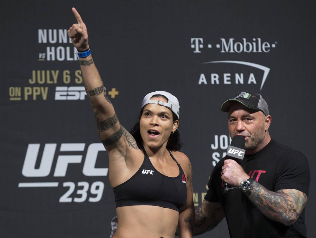 UFC bantamweight champion Amanda Nunes, left, points at her fans while speaking with Joe Rogan ...