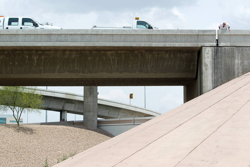 Officials from the Nevada Department of Transportation and Nevada Highway Patrol troopers inves ...