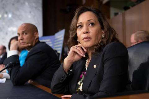 Sen. Kamala Harris, D-Calif., and Sen. Cory Booker, D-N.J., left. (AP Photo/J. Scott Applewhite)