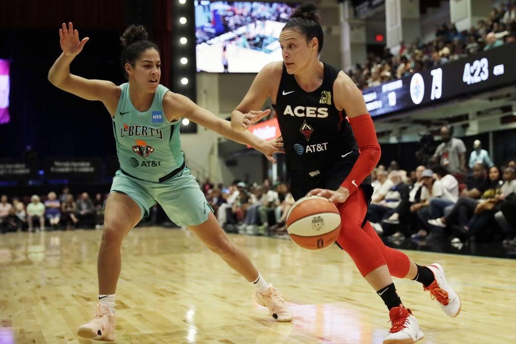 New York Liberty's Kia Nurse, left, defends against Las Vegas Aces' Kayla McBride in the second ...