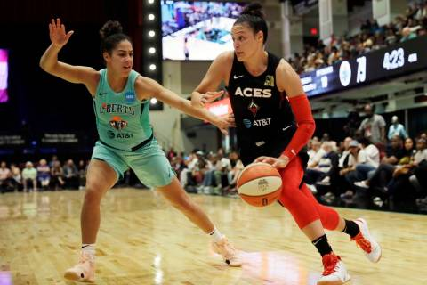 New York Liberty's Kia Nurse, left, defends against Las Vegas Aces' Kayla McBride in the second ...