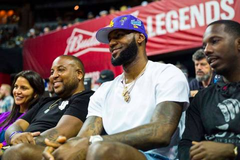 Los Angeles Lakers star LeBron James attends a basketball game between the Lakers and the Chica ...