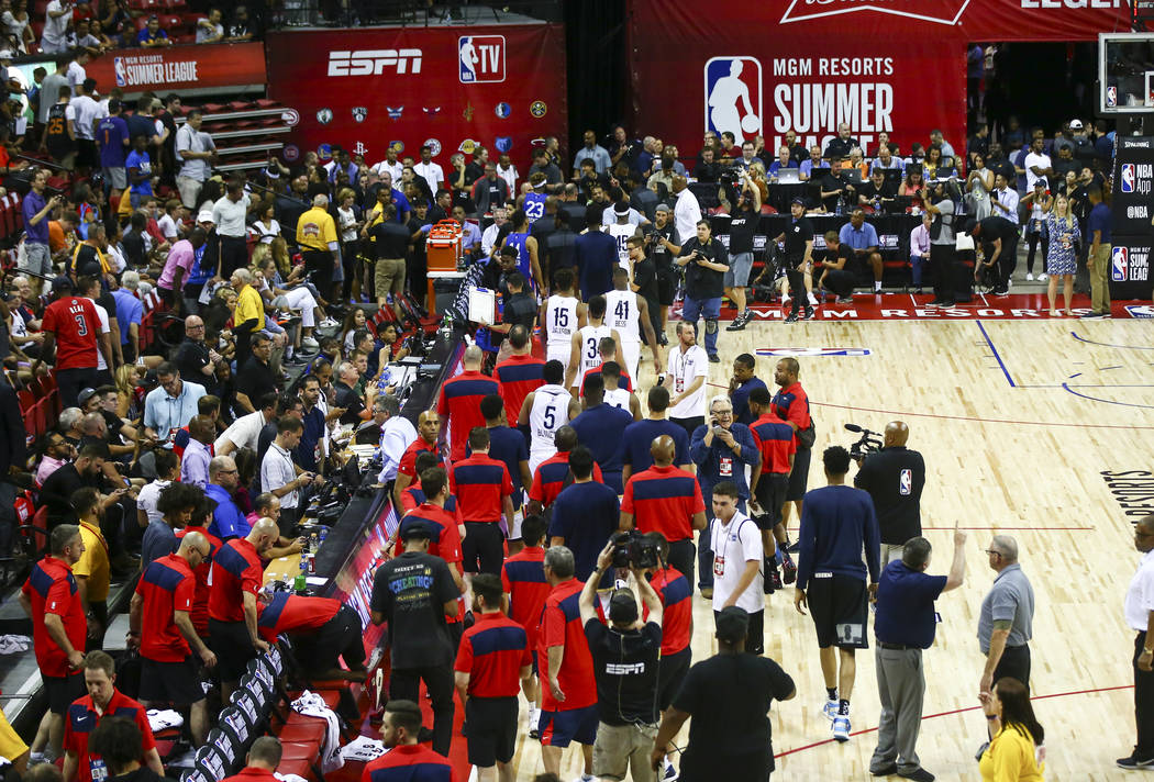 Members of the New York Knicks and the New Orleans Pelicans walk off the court after an earthqu ...