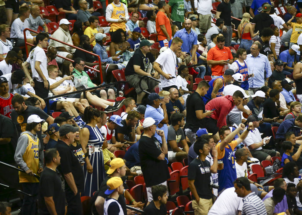 Fans react after an earthquake stopped a basketball game between the New York Knicks and the Ne ...