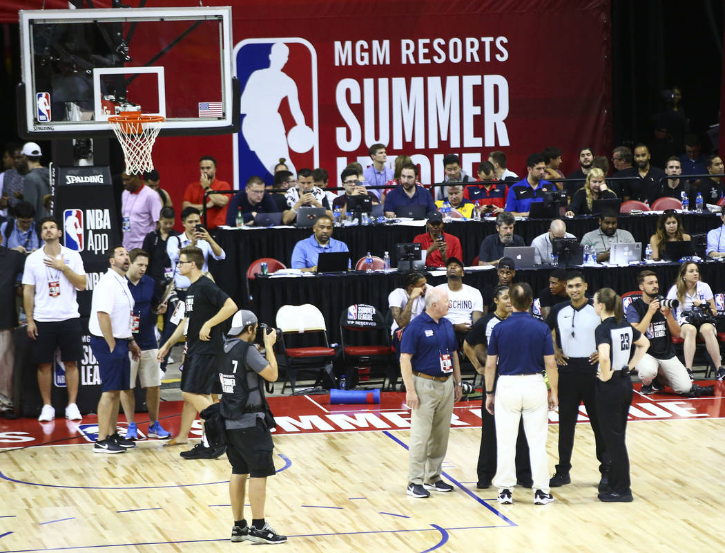 Officials talk after an earthquake stopped a basketball game between the New York Knicks and th ...
