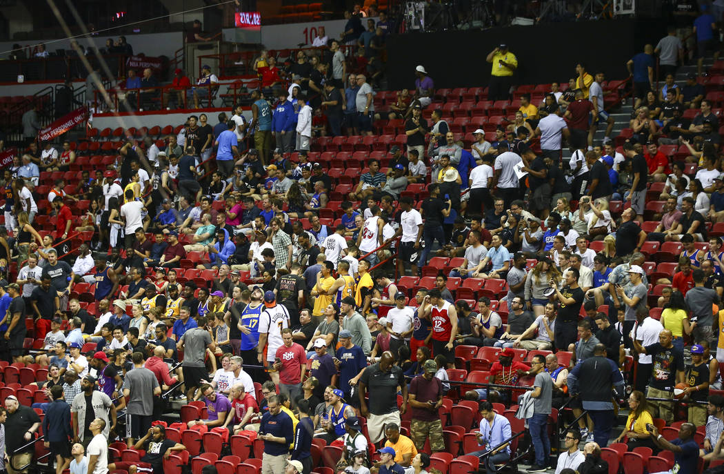 Fans leave the arena after an earthquake stopped a basketball game between the New York Knicks ...