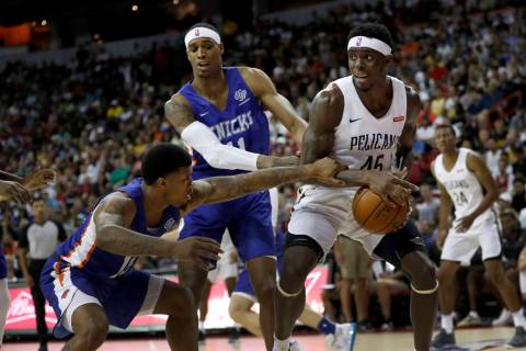 New Orleans Pelicans' Zylan Cheatham (45) is fouled by New York Knicks' Lamar Peters (16) Knick ...