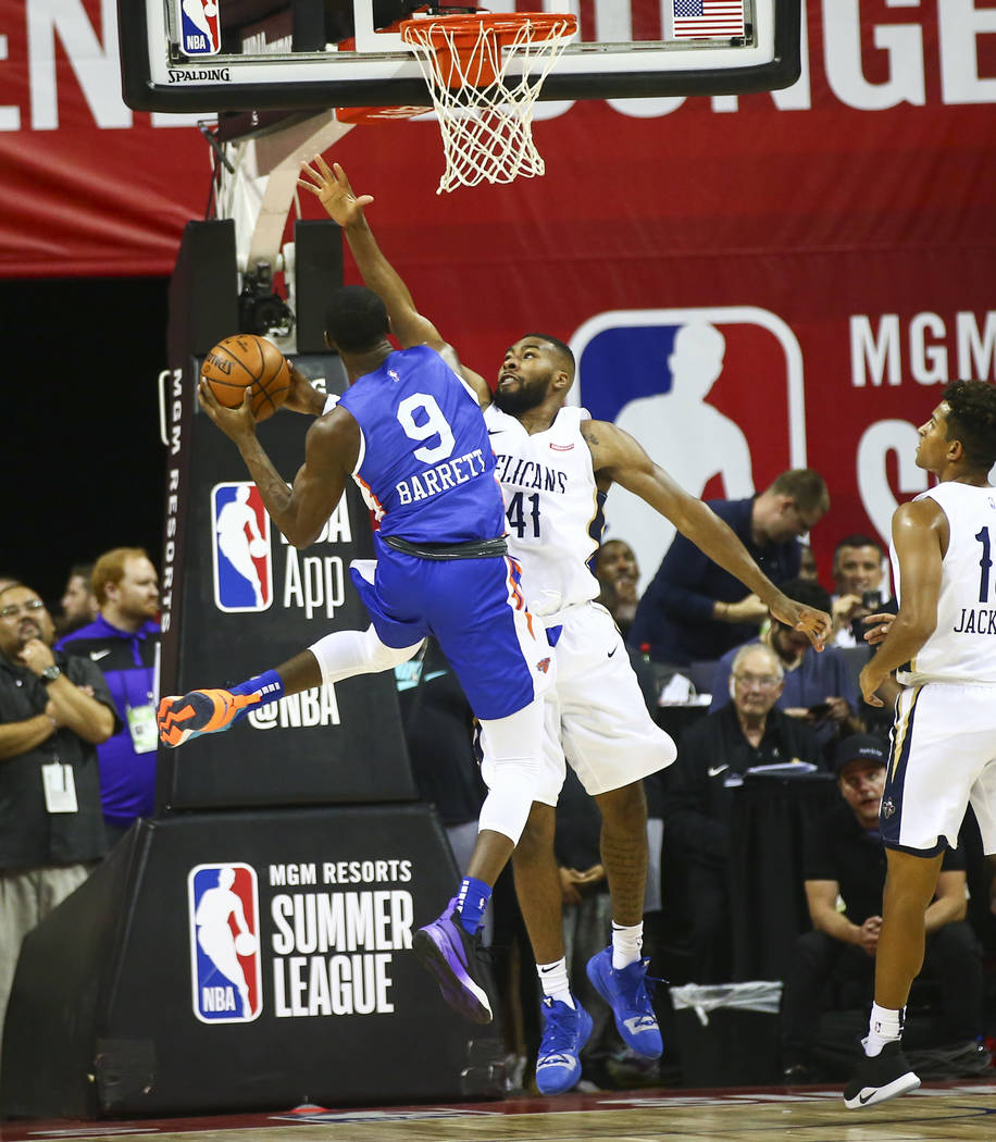 New York Knicks' RJ Barrett goes to the basket against Javon Bess (41) during the first half of ...