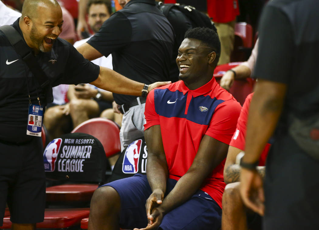 New Orleans Pelicans' Zion Williamson shares a laugh with a member of staff on his team before ...