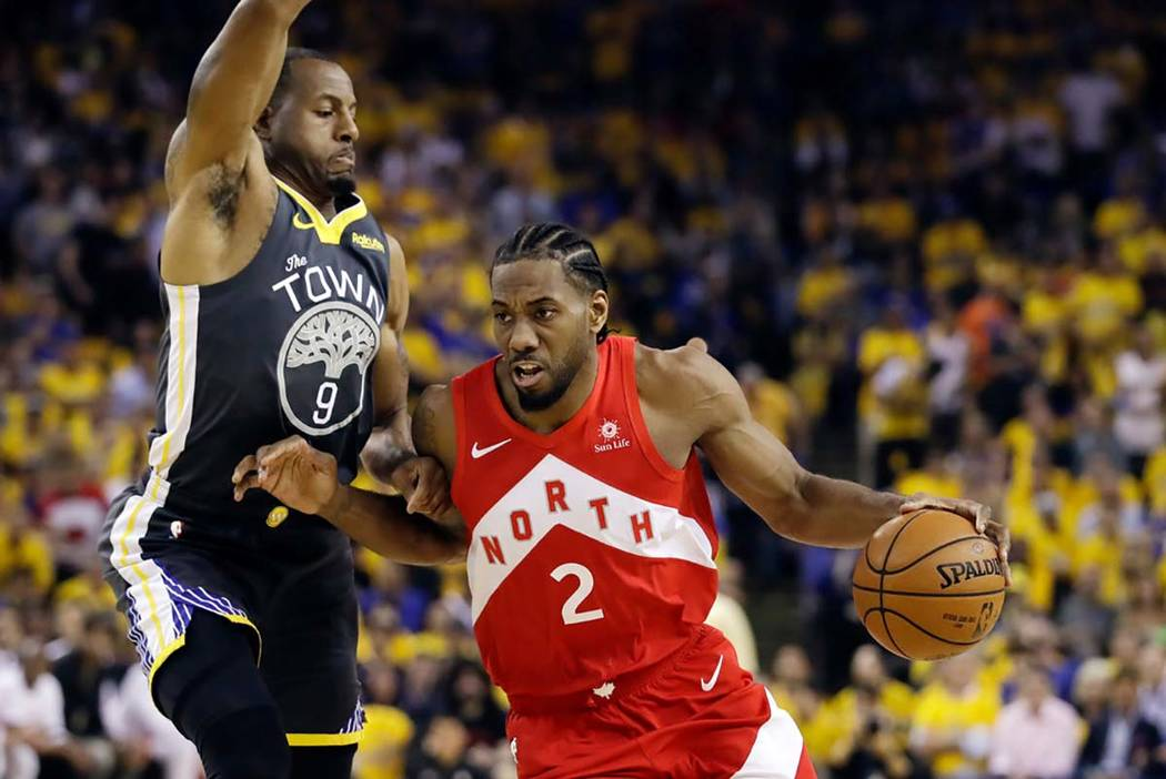 n this June 13, 2019, file photo, Toronto Raptors forward Kawhi Leonard (2) drives against Gold ...