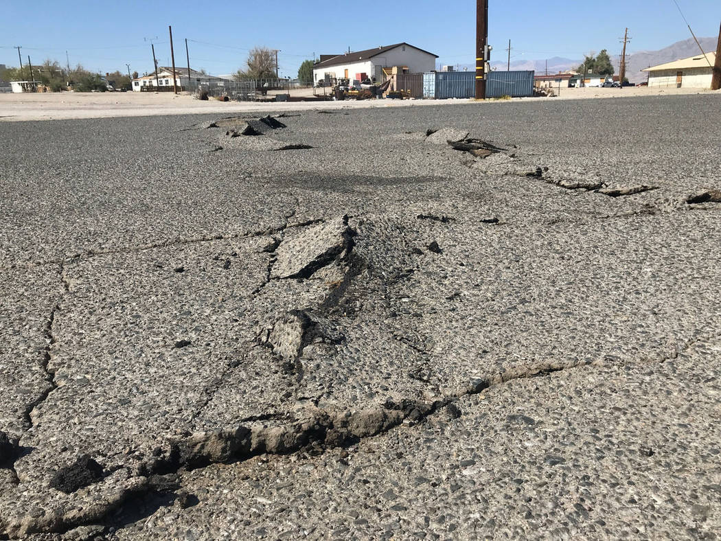 A road is damaged from an earthquake Thursday, July 4, 2019, in Trona, Calif. A strong earthqua ...