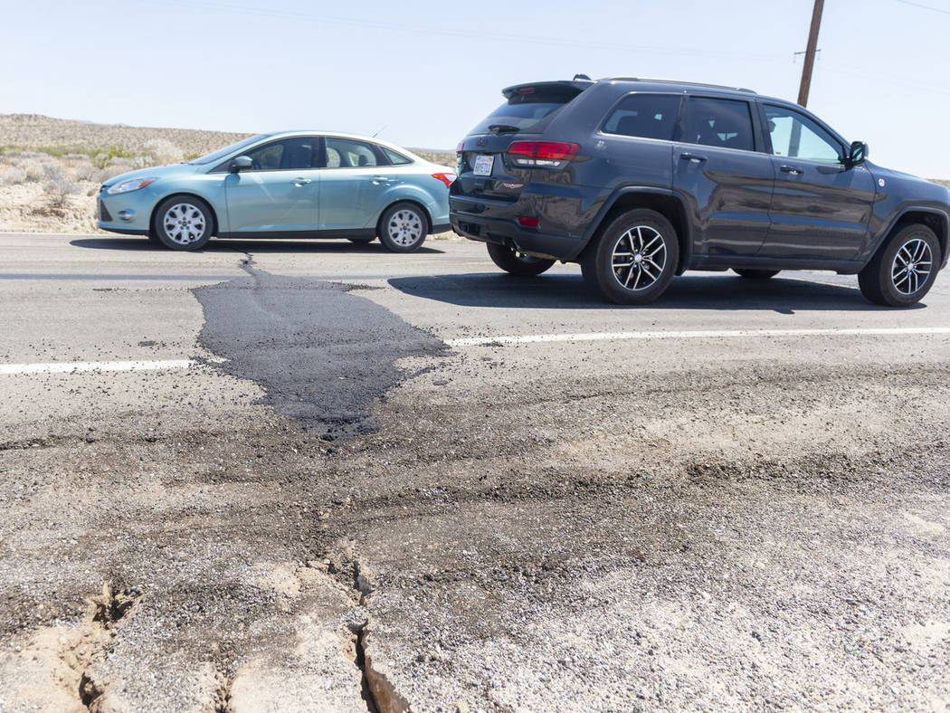 Traffic drives over a patched section of Highway 178 between Ridgecrest and Trona, Calif., on F ...