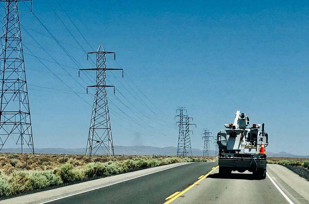 A utility repair vehicle makes its way up Highway 395 to Ridgecrest, Calif., Saturday, July 6, ...