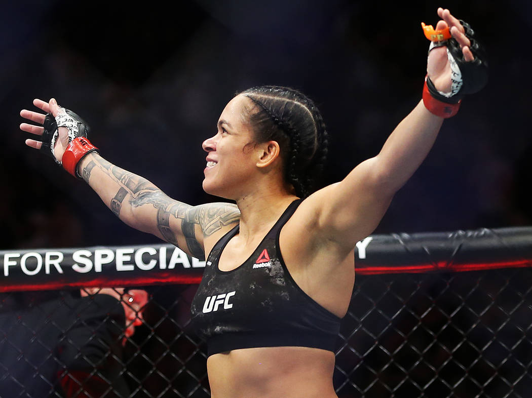 Amanda Nunes celebrates after beating Holly Holm in the first round during their bantamweight t ...