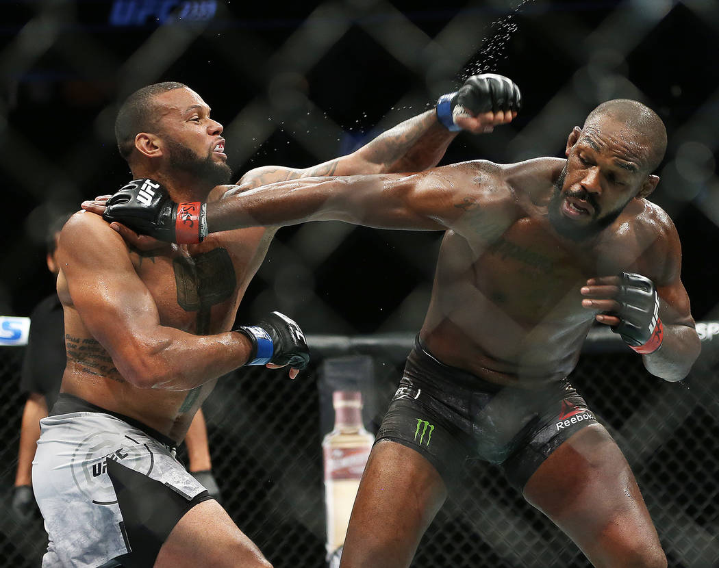 Thiago Santos, left, throws a left hook against Jon Jones in the second round during their ligh ...