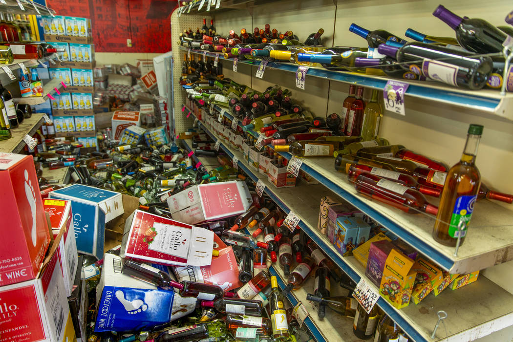 Wine bottles and other merchandise are scattered about the Eastridge Market Liquor Store which ...