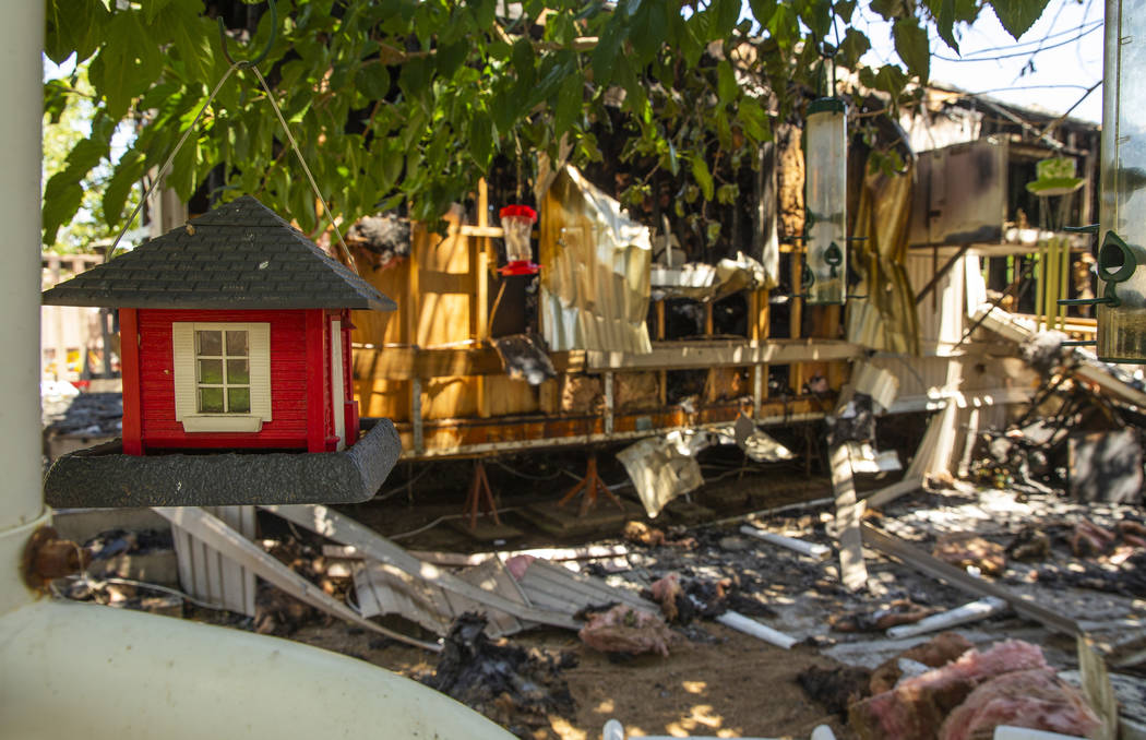 A birdhouse is one of few things remaining after a fire at the Town and Country Mobile Home Par ...