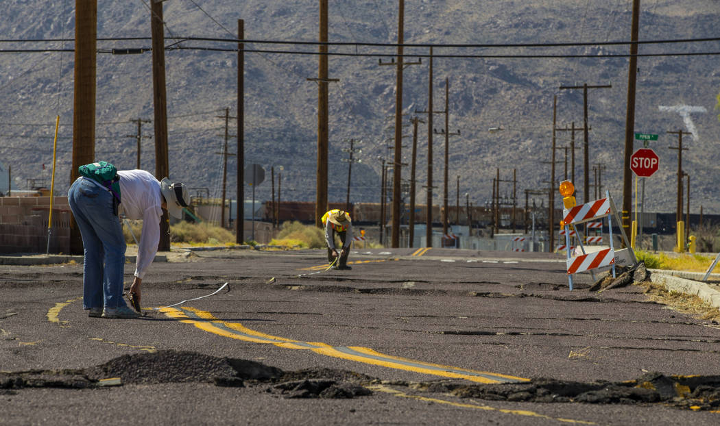Scientists working along side the USGS measure and monitor the extensive cracks with shifting p ...