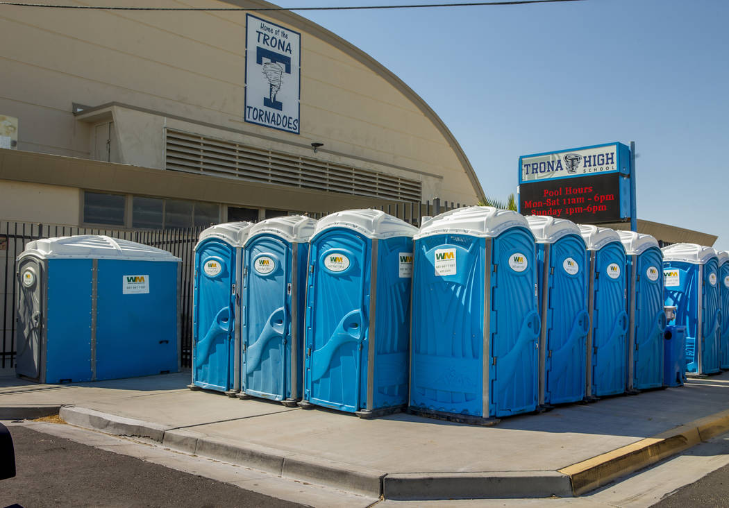 A line of porta potty's line the sidewalk outside the Trona High School as water and other supp ...