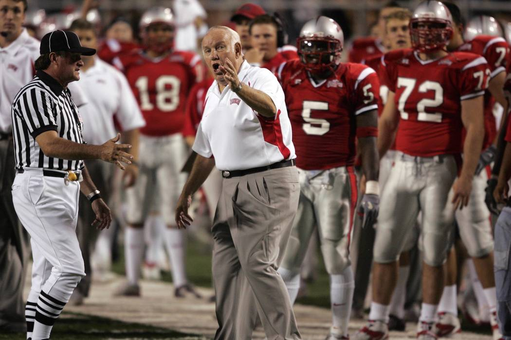 UNLV Head Coach John Robinson argues a call after watching the replay while playing against Nev ...