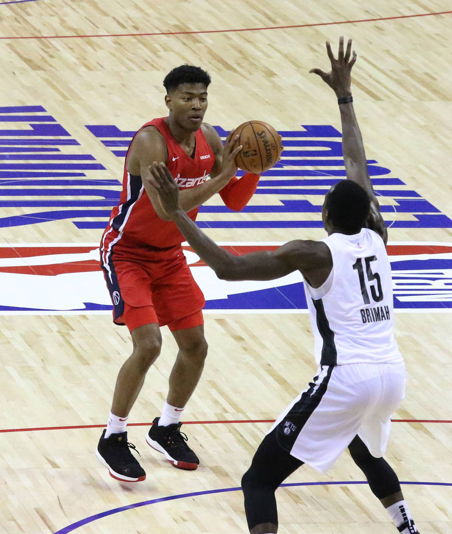 The Washington Wizards' forward Rui Hachimura (8) prepares to shoot to the basket as the Brookl ...