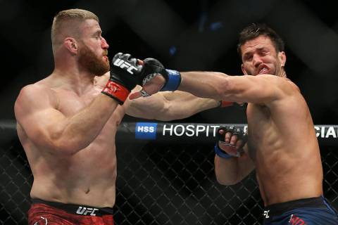 Jan Blachowicz, right, connects with a right hook against Luke Rockhold in the second round dur ...